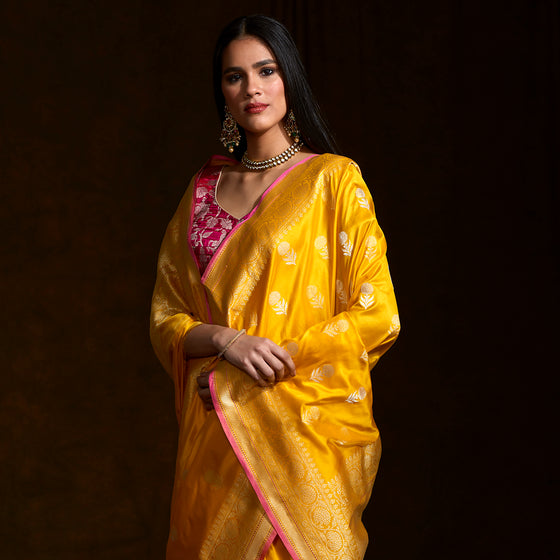 6b571a5e5e1f9d Yellow katan silk saree with floral motifs and a delicate kadhwa border  with a pink selvedge ...