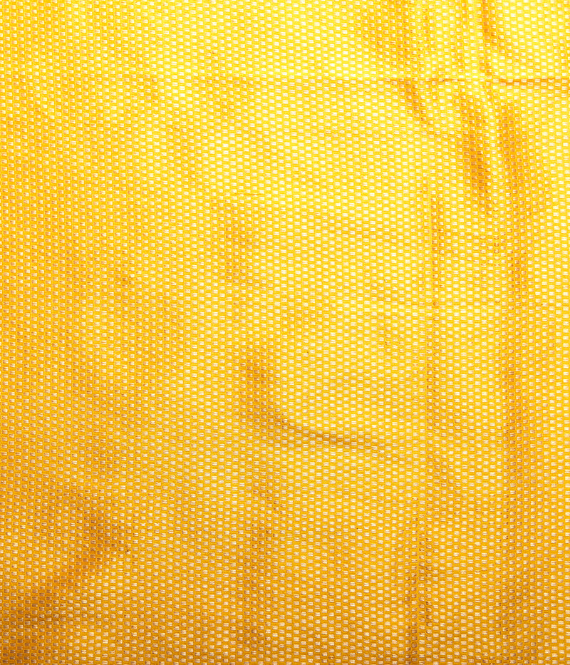 Yellow katan silk saree with floral motifs and a delicate kadhwa border with a pink selvedge