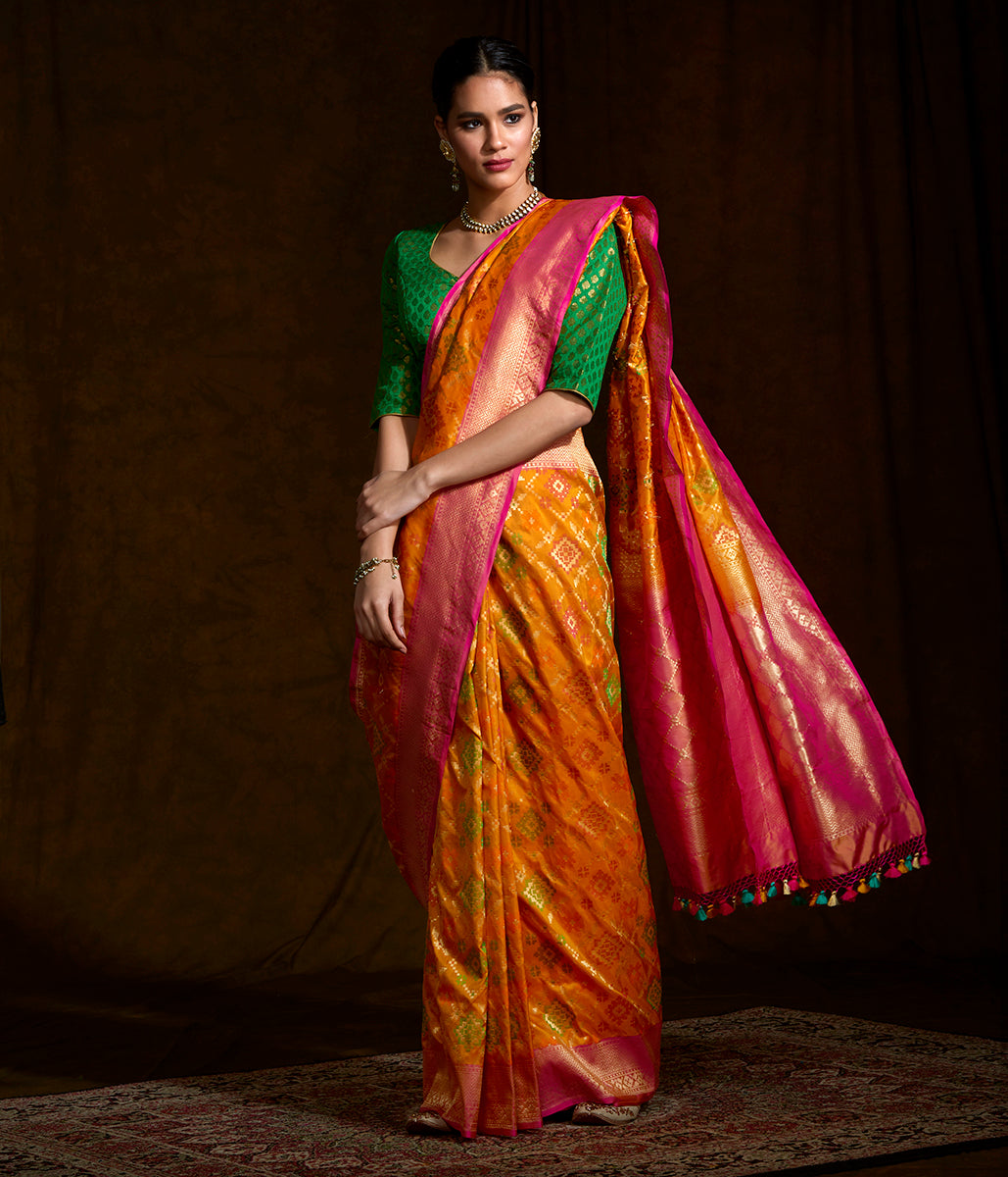 Handwoven Banarasi Patola saree in orange with pink border
