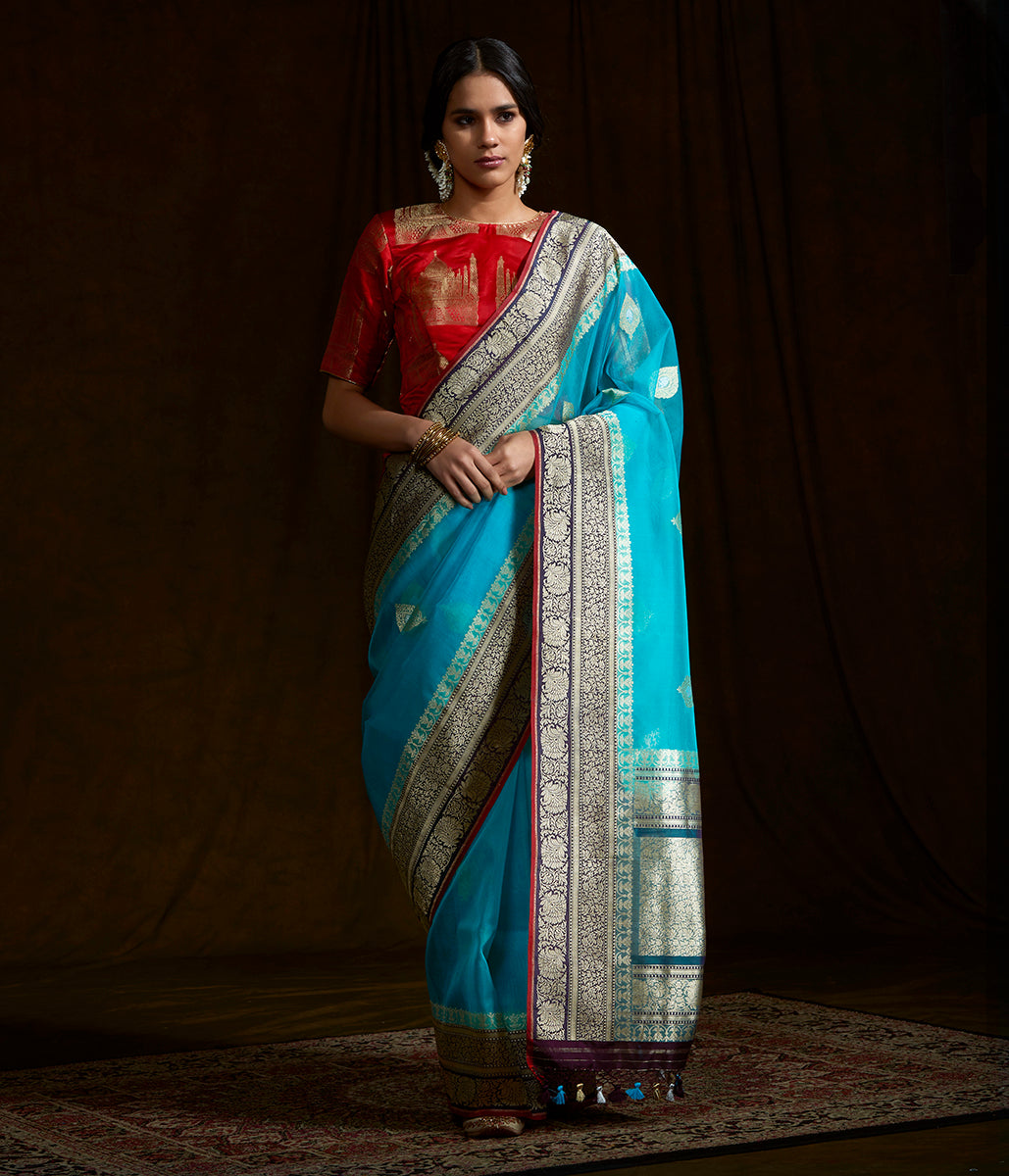 Blue banarasi kora silk saree with wine border and pallu and red selvedge
