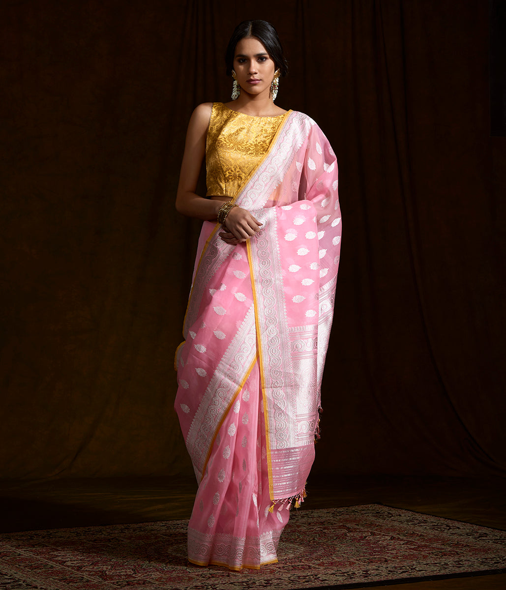 Pink banarasi kora silk saree with kadhwa booti and beldaar border