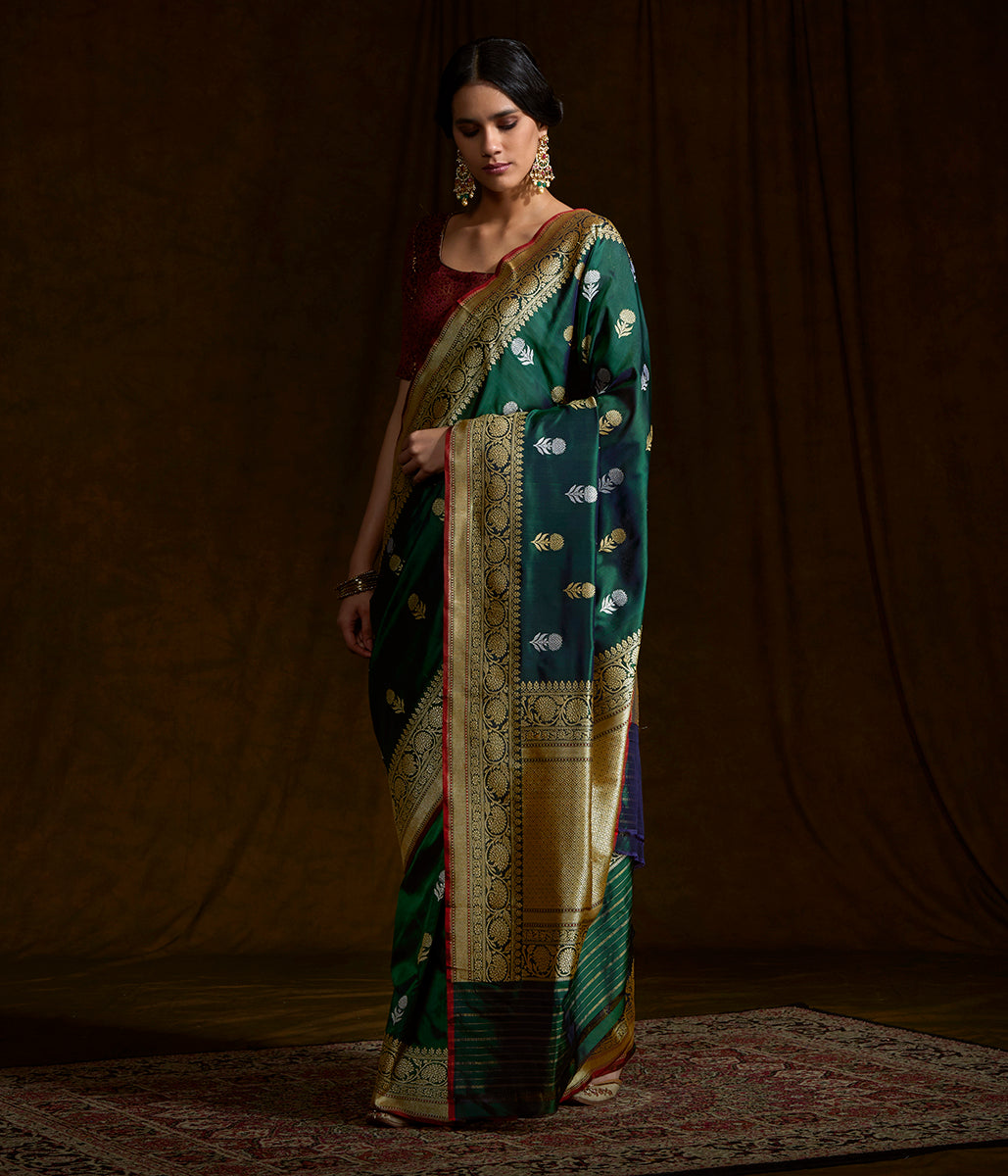 Emerald Green katan silk saree with floral motifs and a delicate kadhwa border with red selvedge