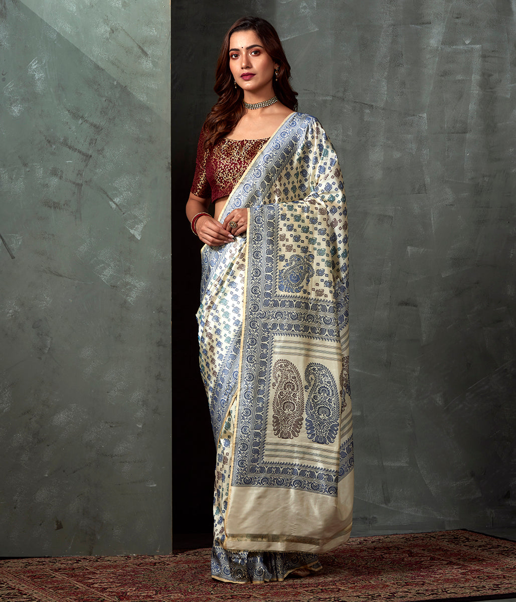 Handwoven Banaras Baluchari in Offwhite with Blue and Green Kairi and Koniya