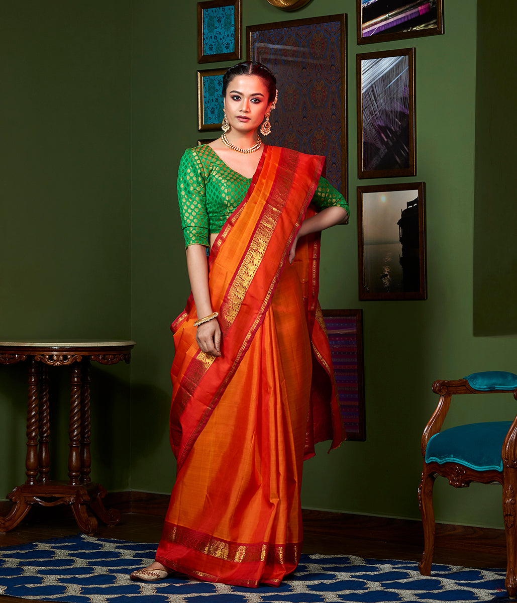 Handwoven Orange and Red Kanjivaram silk saree with annapakshi border