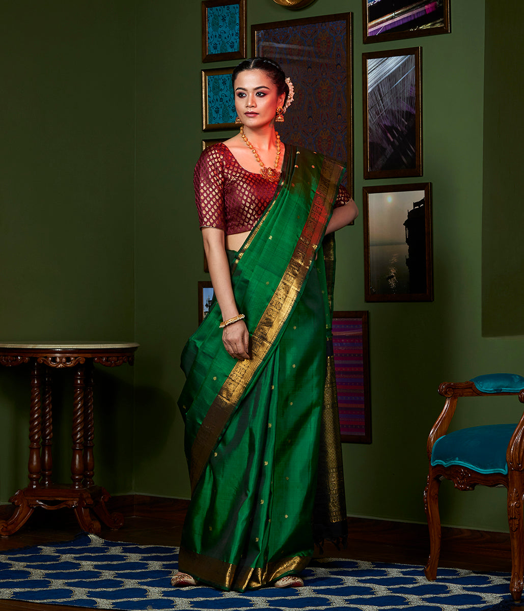 Handwoven emerald green kanjivaram silk saree with pure zari border