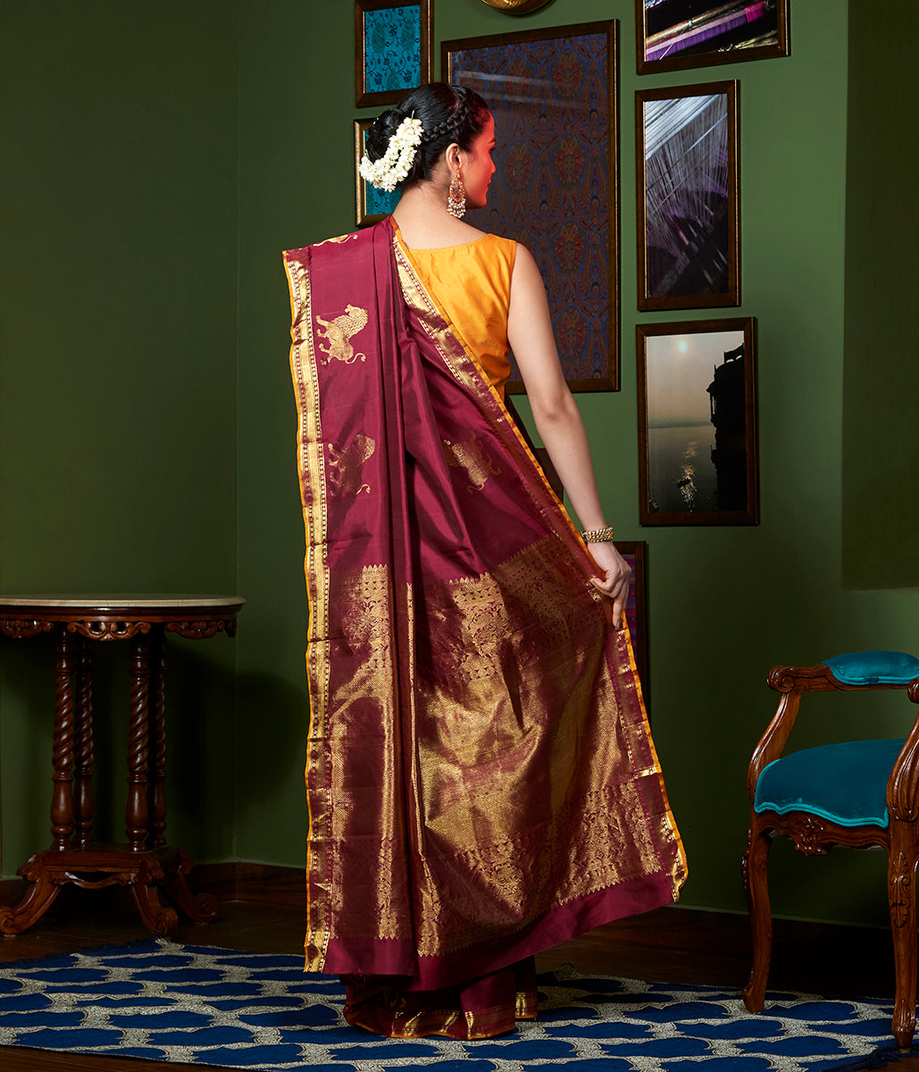 Handwoven Mahroon Kanjivaram Silk Saree with Lions woven in Gold Zari