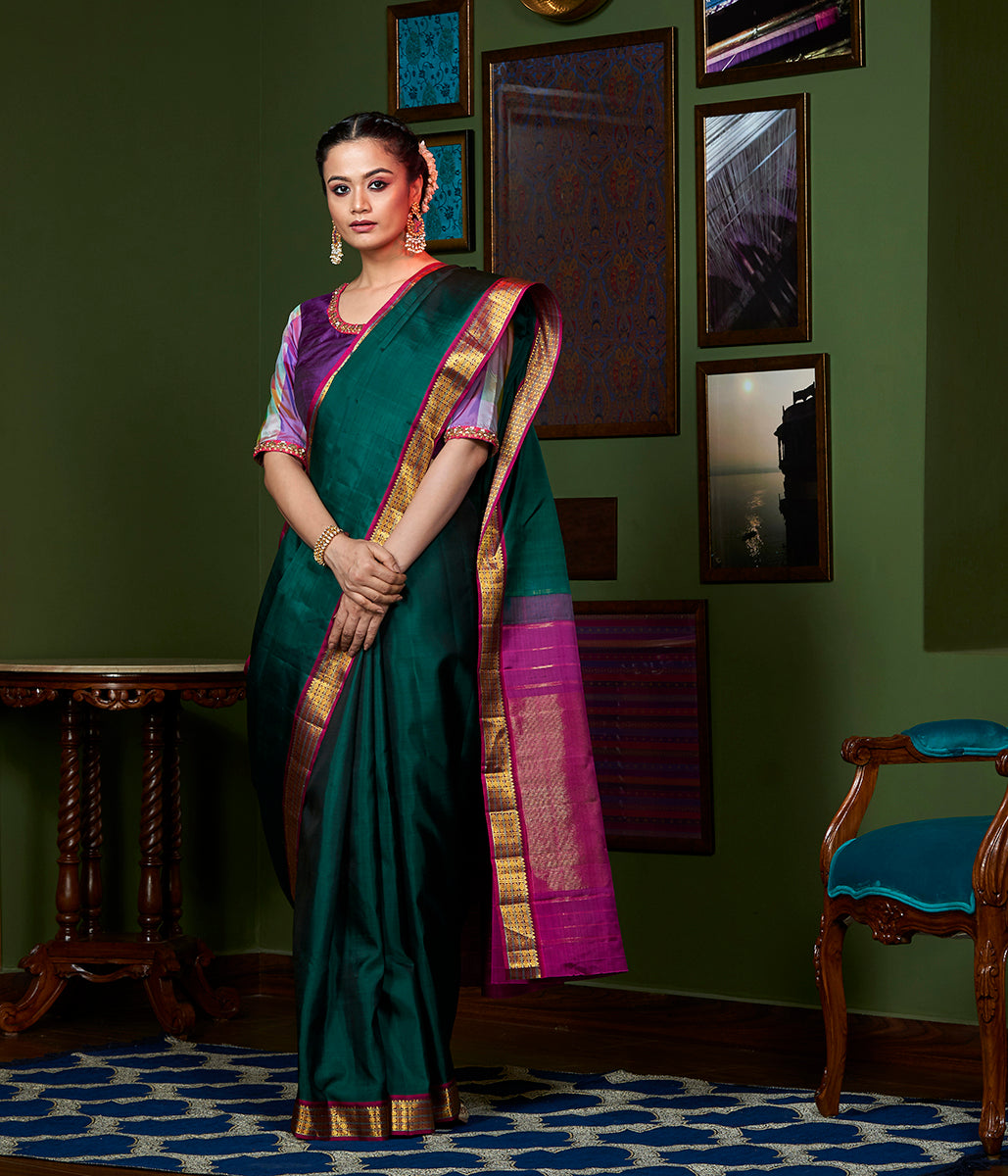 Handwoven Emerald Green and Pink Kanjivaram Silk Saree with Gold Zari Border