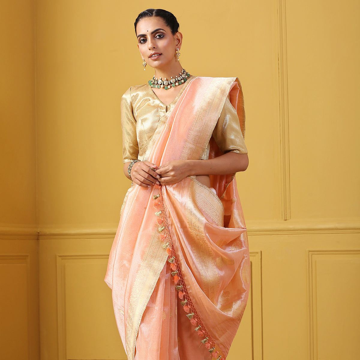 Handwoven Peach Cotton Tissue saree with kadhwa booti