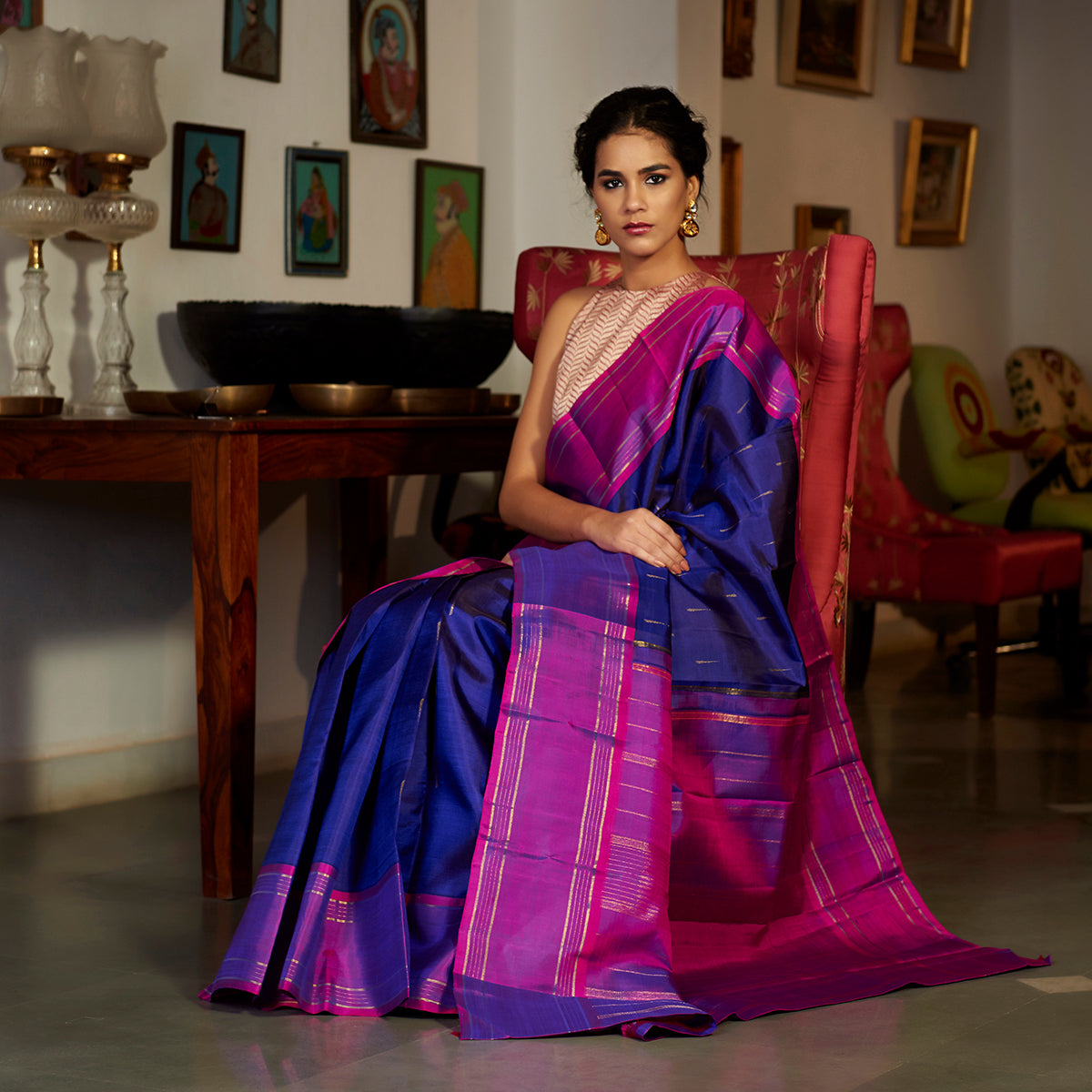 Blue Kanjivaram silk saree with a contrast border and delicate zari motifs
