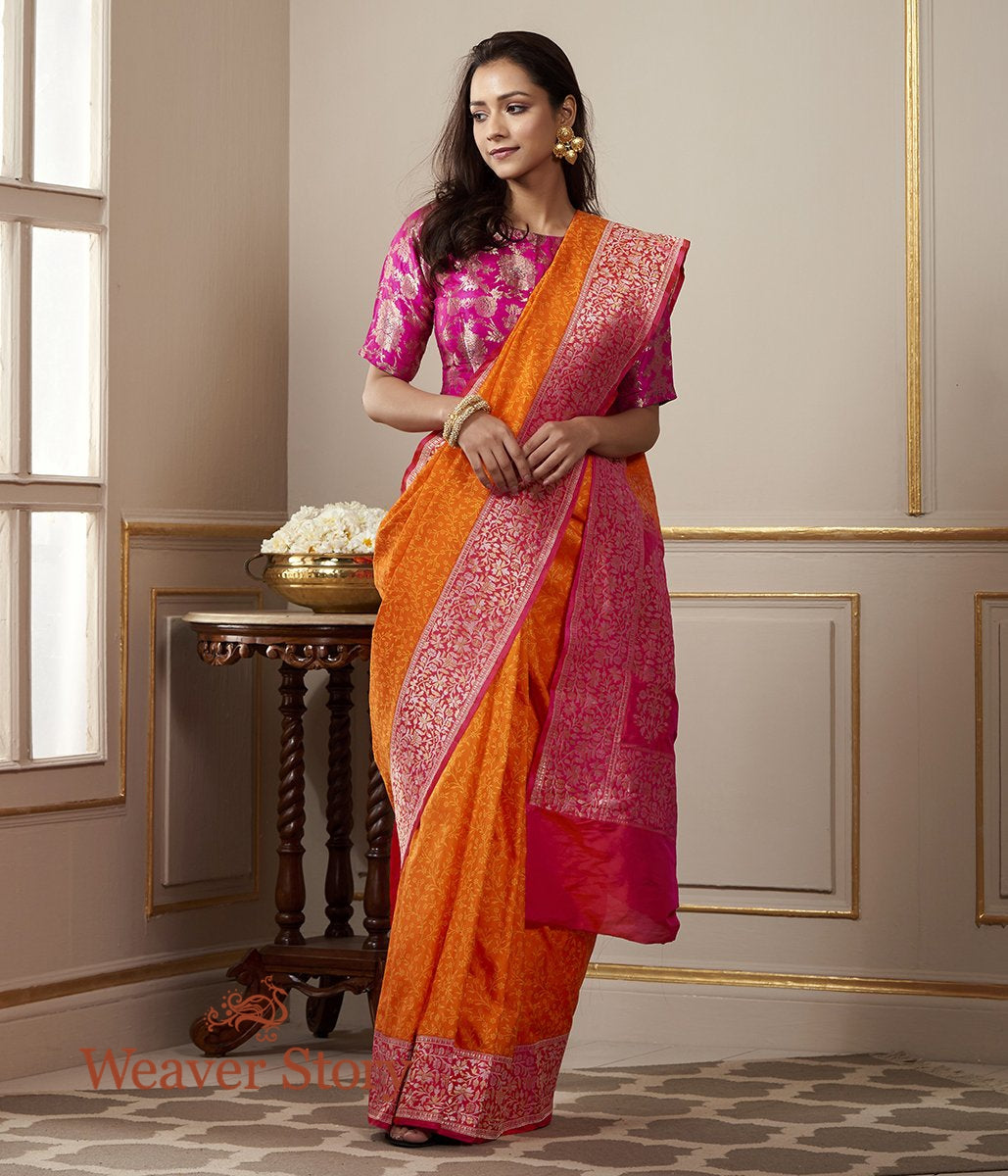 Handwoven Orange and Pink Banarasi Tanchoi Saree with Kadhwa Border with Woven Leaf Motifs