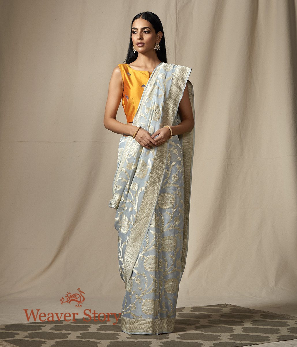 Handwoven Banarasi Georgette Jaal in Soft Blue with a Champaign Color Zari Jaal