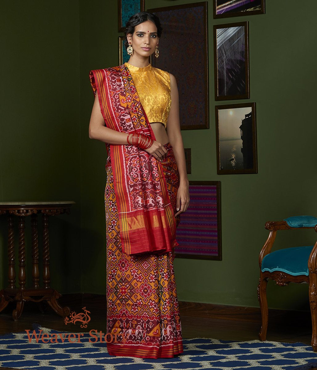 Handwoven Mustard and Red Gujarat Patola Saree with Red Border