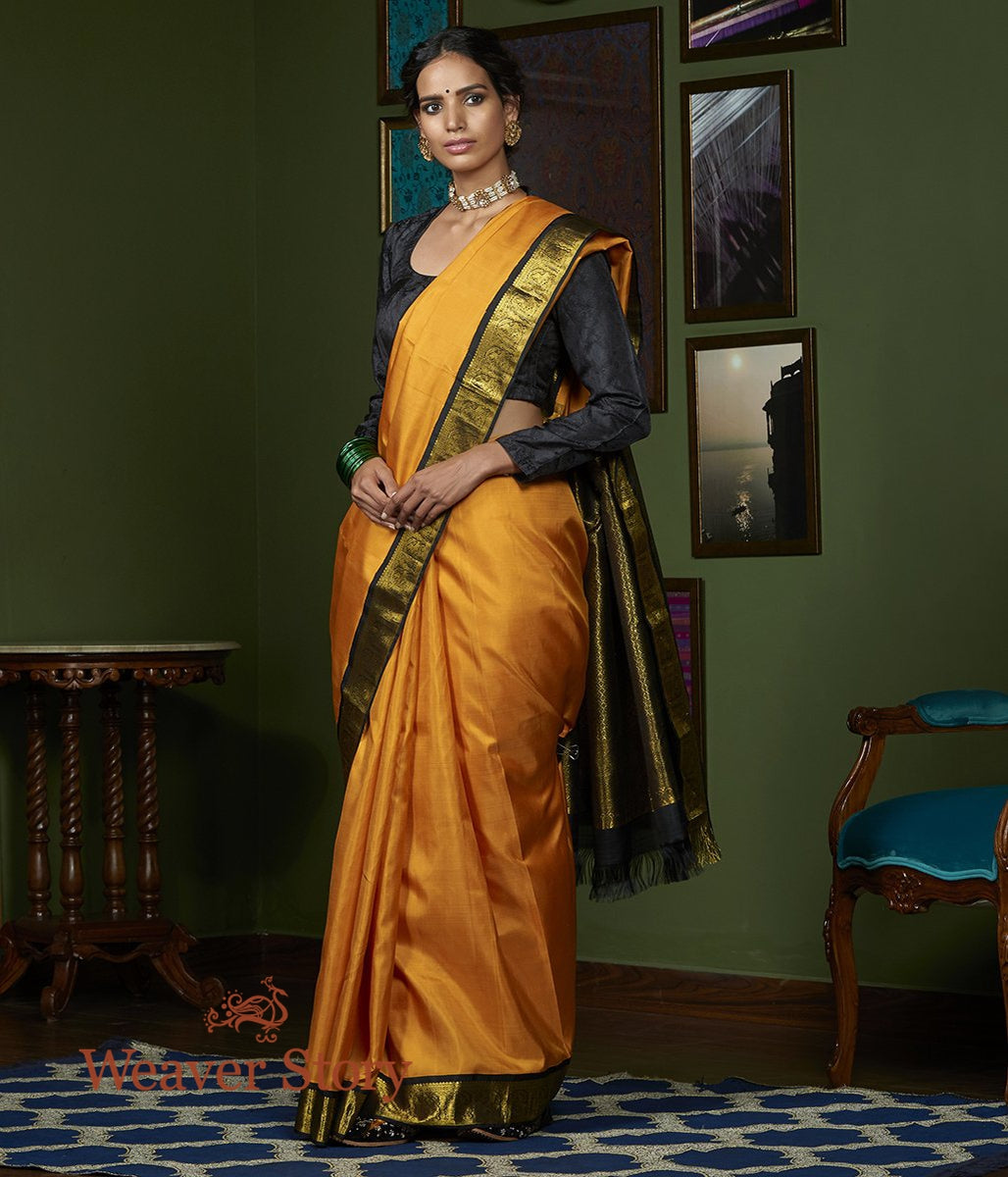 Handwoven Yellow Kanjivaram Silk Saree with Black Border and Pallu