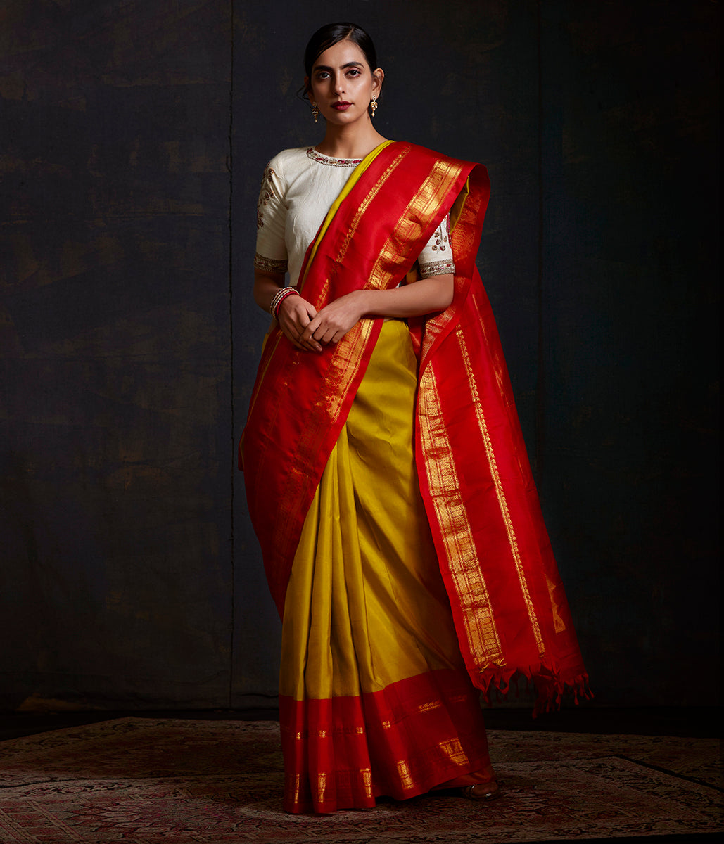 Handwoven Green Kanjivaram Saree with Contrast Red Border