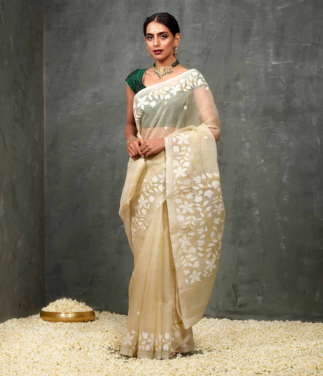 Handwoven Muslin Jamdani Saree in a Pale Pistachio Green color