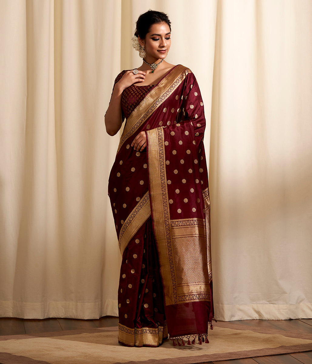 Handwoven asgarfi boota banarasi saree in an mahroon and brown dual tone