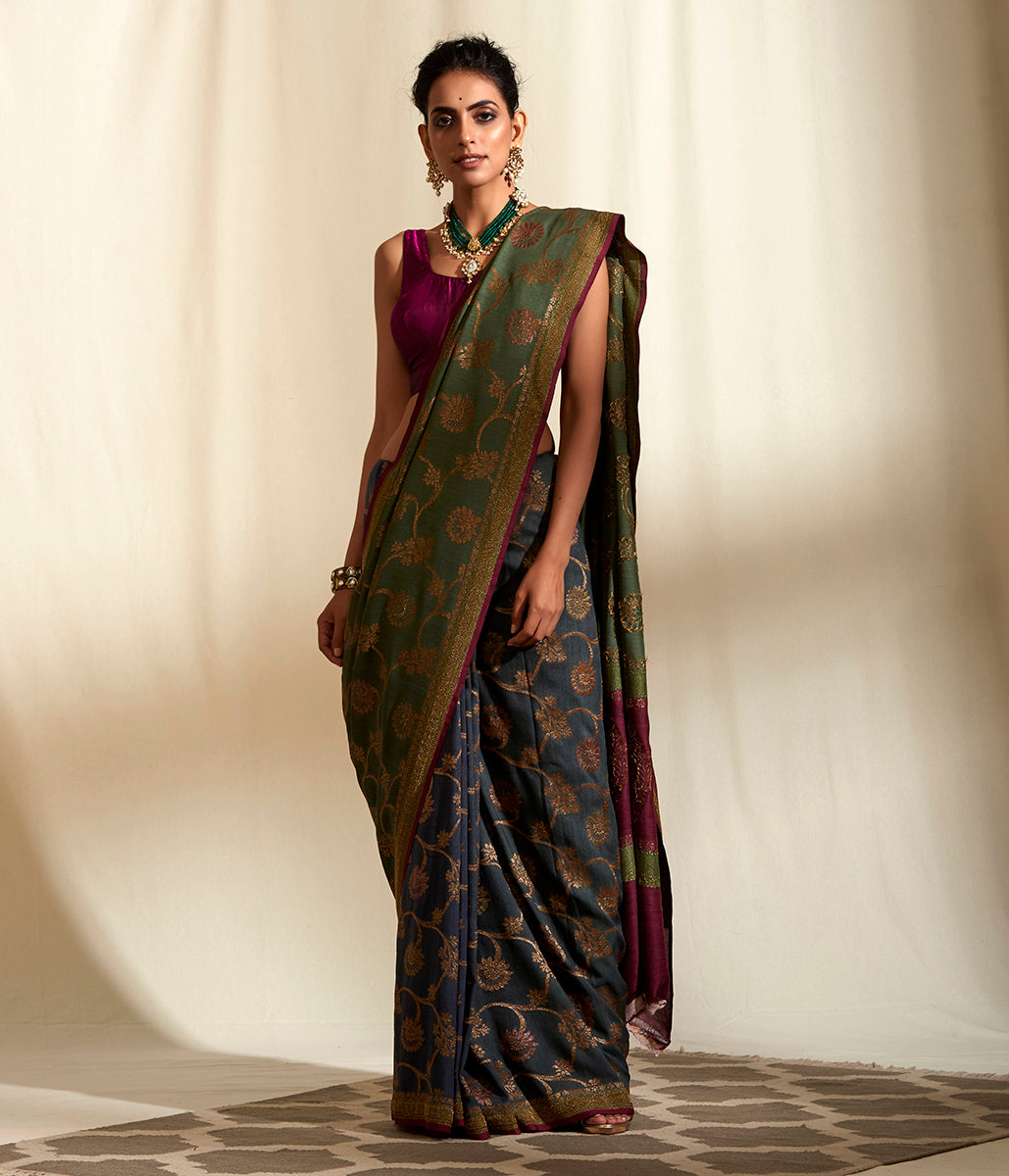 Handwoven dark green munga silk saree with floral jangla