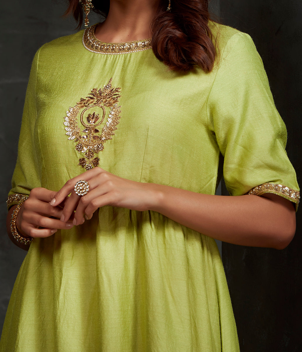 Hand front boota embroidered munga silk suit in green color with brocade palazzo