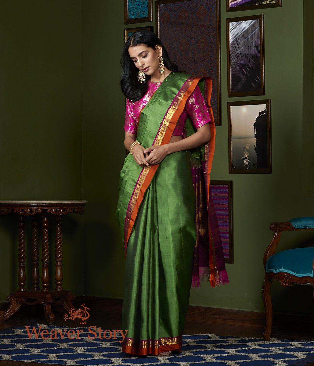 Handwoven Green Kanjivaram Silk Saree with Orange and Wine Border