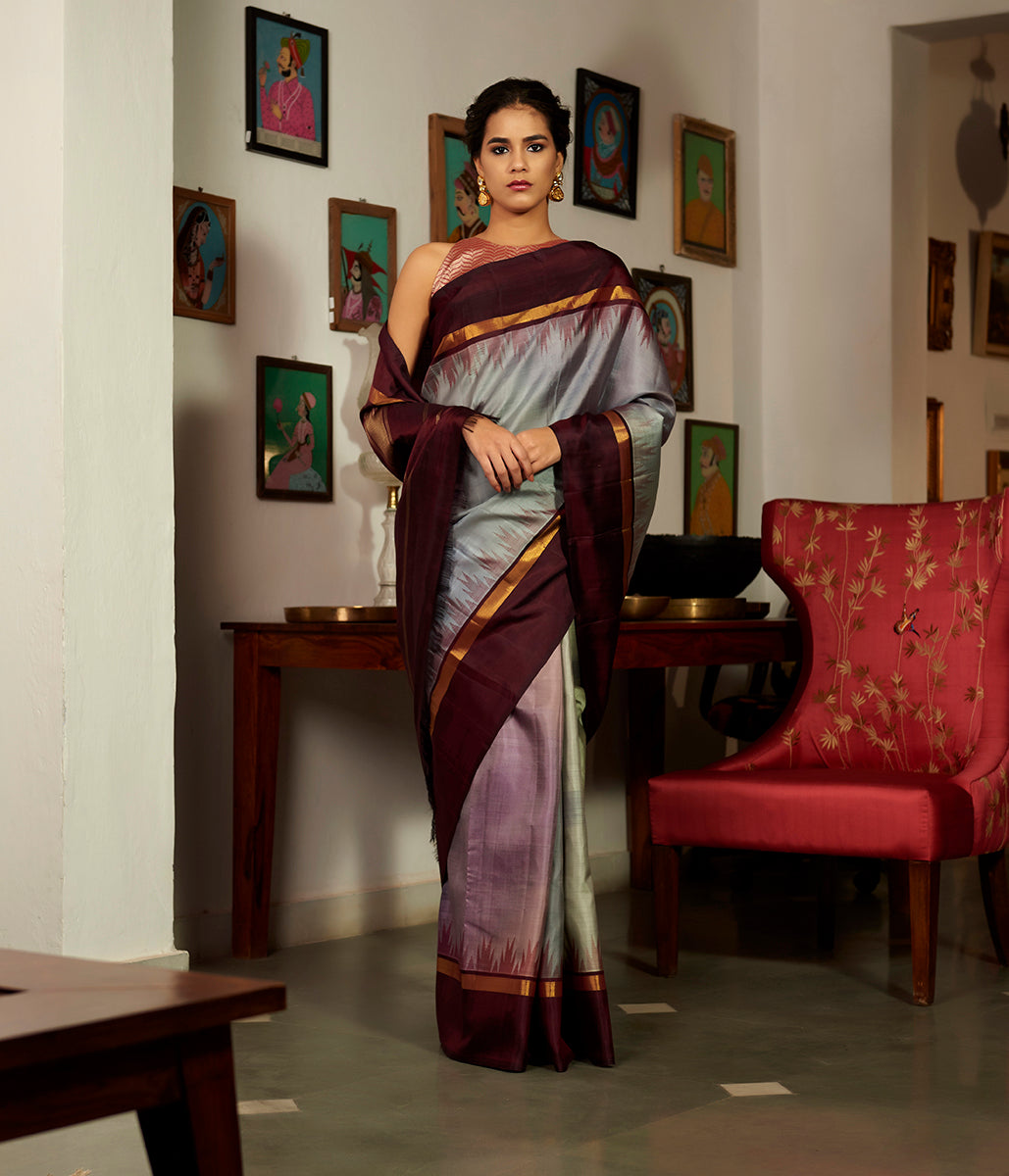 Slate grey Kanjivaram silk saree with a contrast Temple border