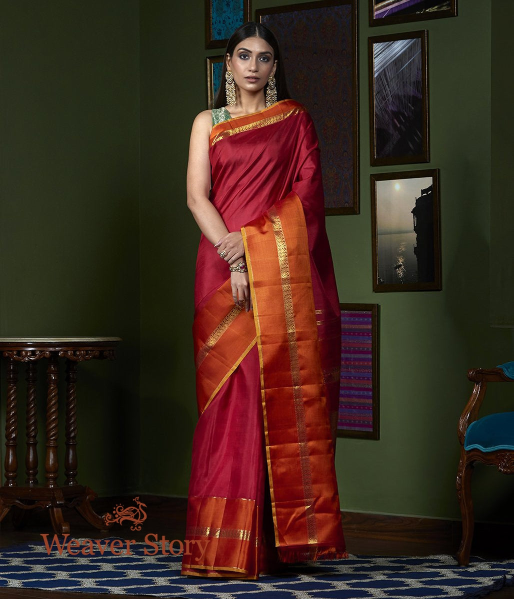 Handwoven Maroon Plain Kanjivaram Orange Broad Border