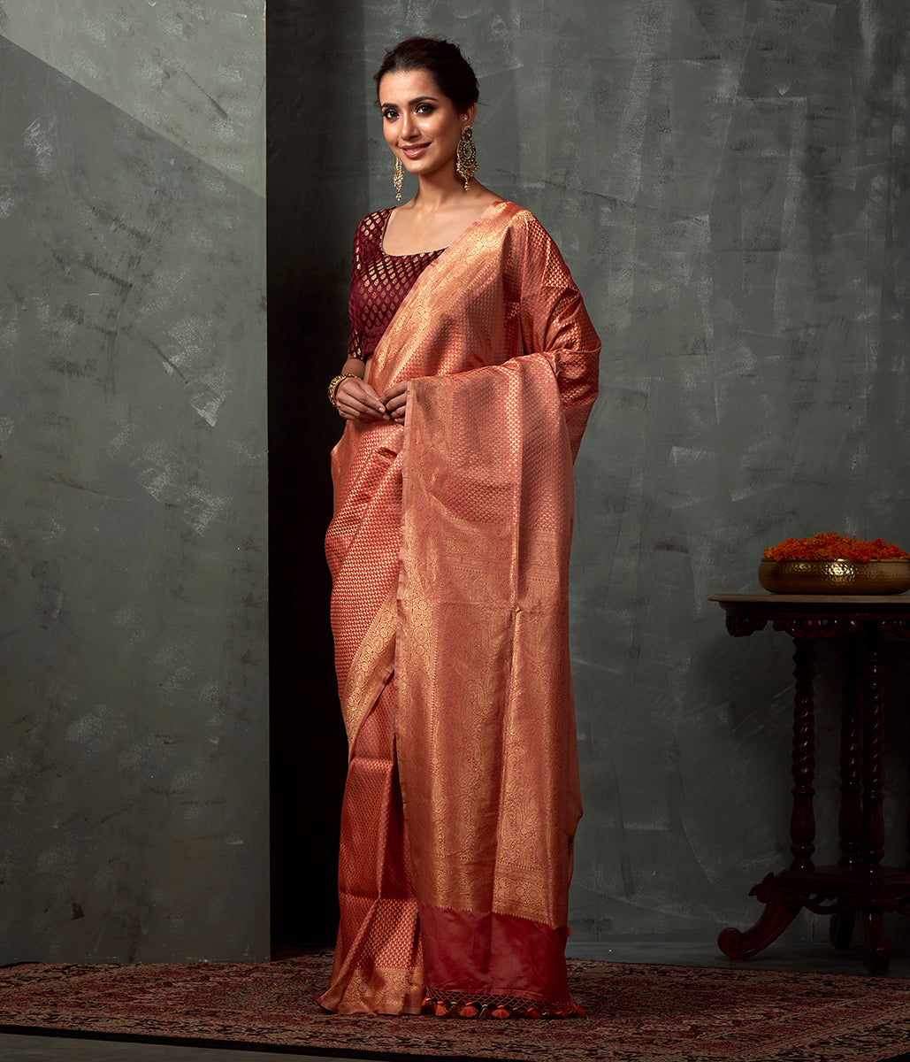 Handwoven Peach Katan Silk saree with Small Paislye Motifs Woven in Zari