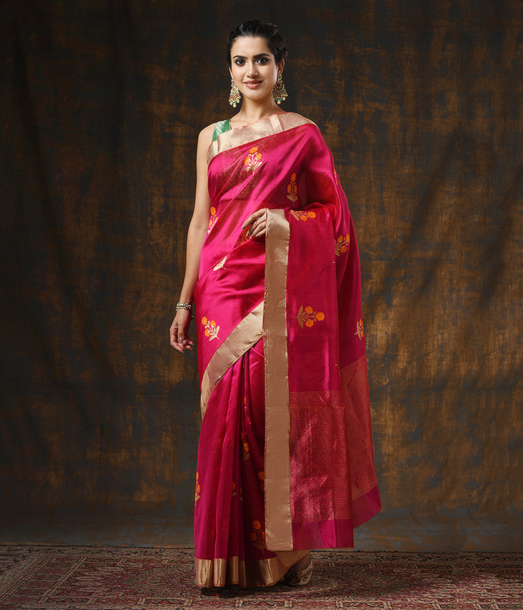 Handwoven Pink Chanderi Silk Saree with Floral Motifs And Heavy Gold Zari Border