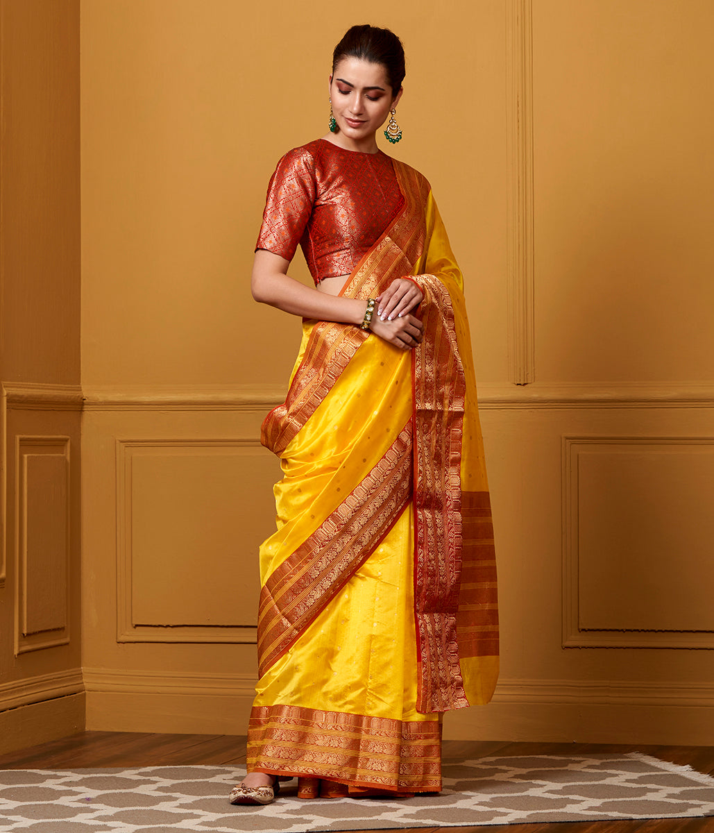 Handwoven Yellow and Red chanderi silk saree with intricate ek naliya weave