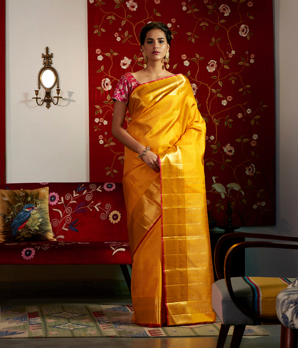 Bright yellow kanjivaram silk saree with real zari