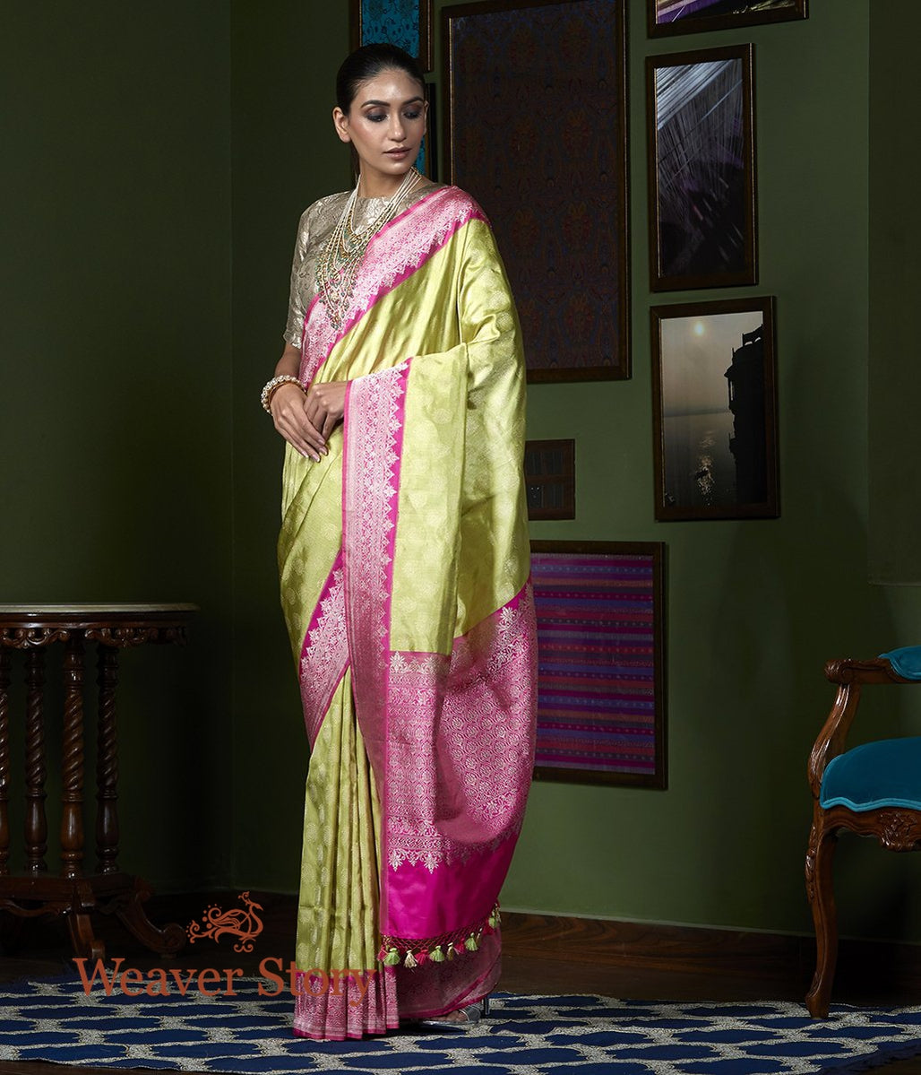 Handwoven Green Tissue Silk Saree with Pink Border