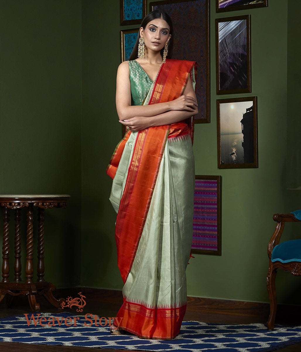 Handwoven Beige Kanjivaram Saree with Orange Temple Border