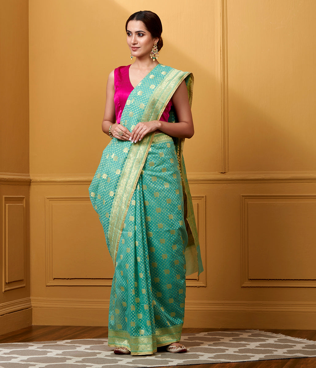Handwoven Green Kora Cotton Saree with small booti