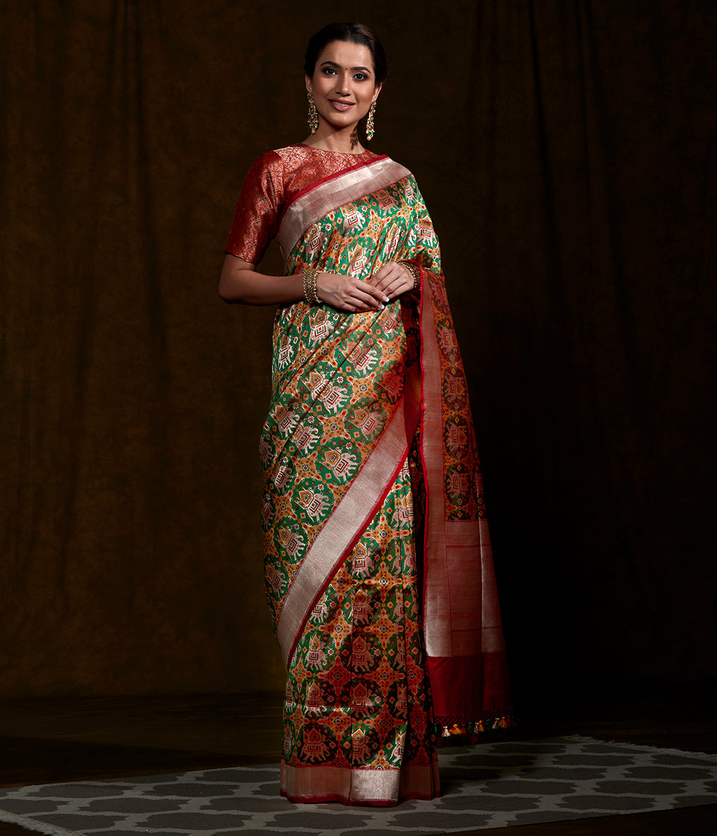 Handwoven Green and Mustard Patola Saree with Elephant Motifs