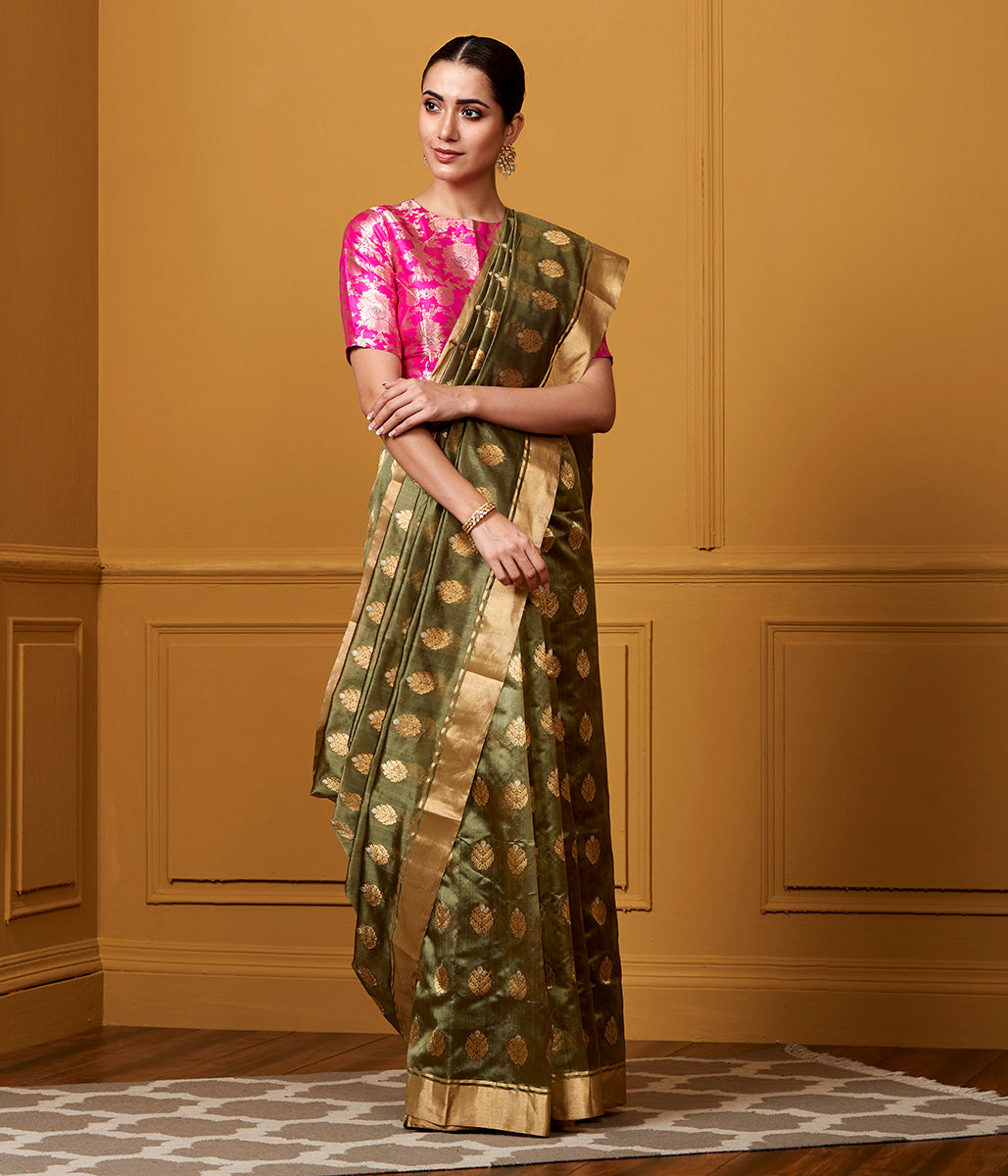 Handwoven Chanderi silk saree in green with all over gold zari booti with meenkari