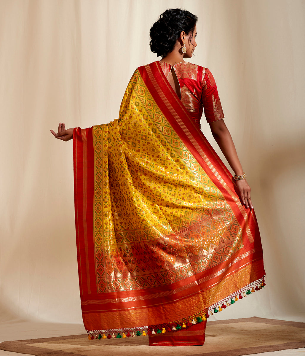 Yellow meenakari patola with red borders and pallu