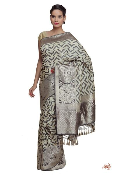 c25675b9ff Ivory and black chevron design banarasi silk saree with bold borders.  Contemporary styling makes this ...