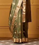 Handwoven Chanderi silk saree in moss green with gold zari motifs