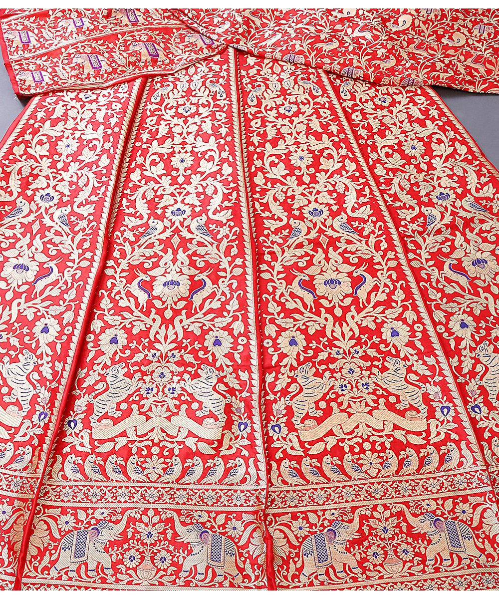 Handwoven kadhwa Banarasi Shikargah Lehenga in Red color with meenakari