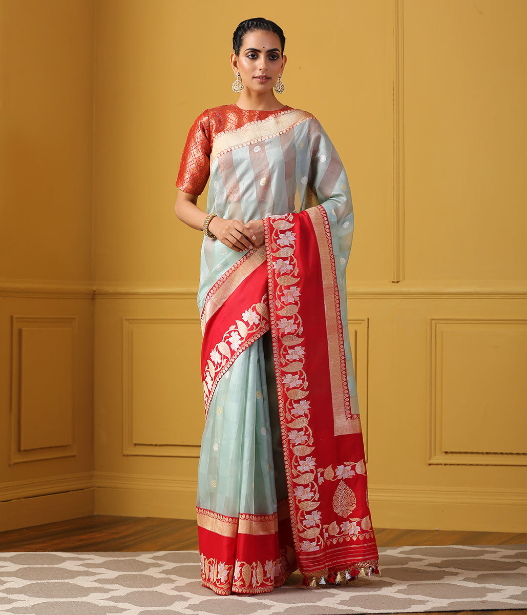 Light blue kora silk banarasi saree with a kadhiyal red border