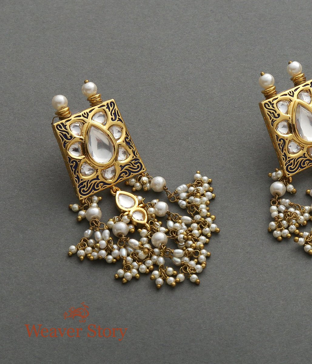 Carved Antique gold earring with Kundans