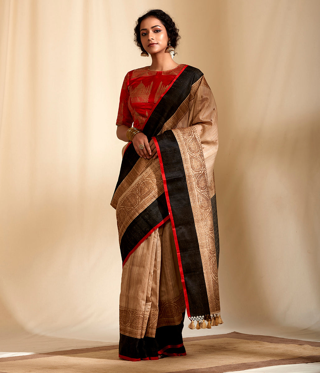 Handwoven banarasi tusser saree with kadhwa boota woven in antique zari and a black border