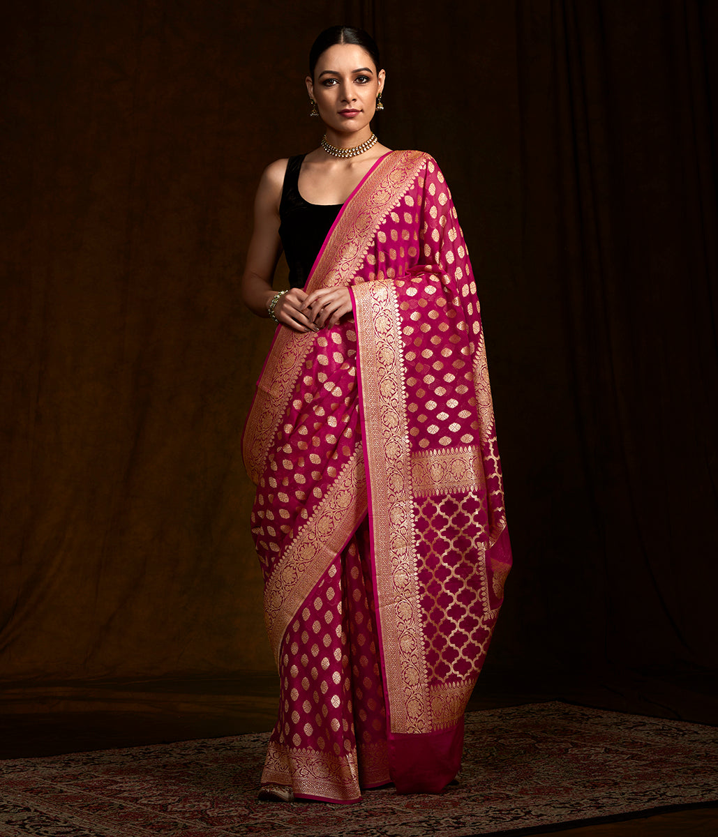Handwoven banarasi georgette saree in dark pink with gold zari motifs