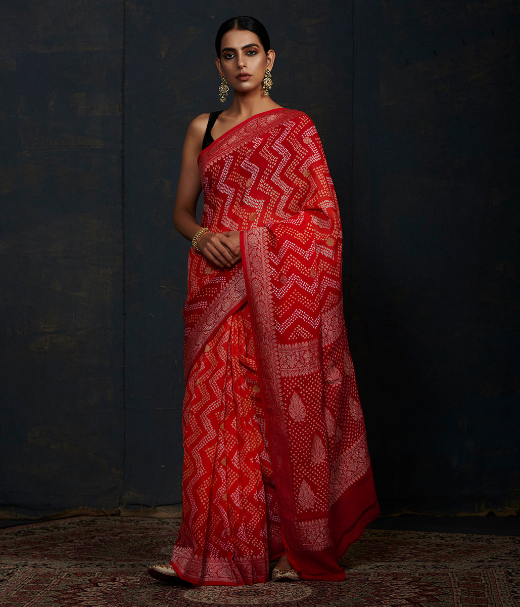 Red and orange ombré dyed Banarasi Bandhej Saree with chevron tie and dye