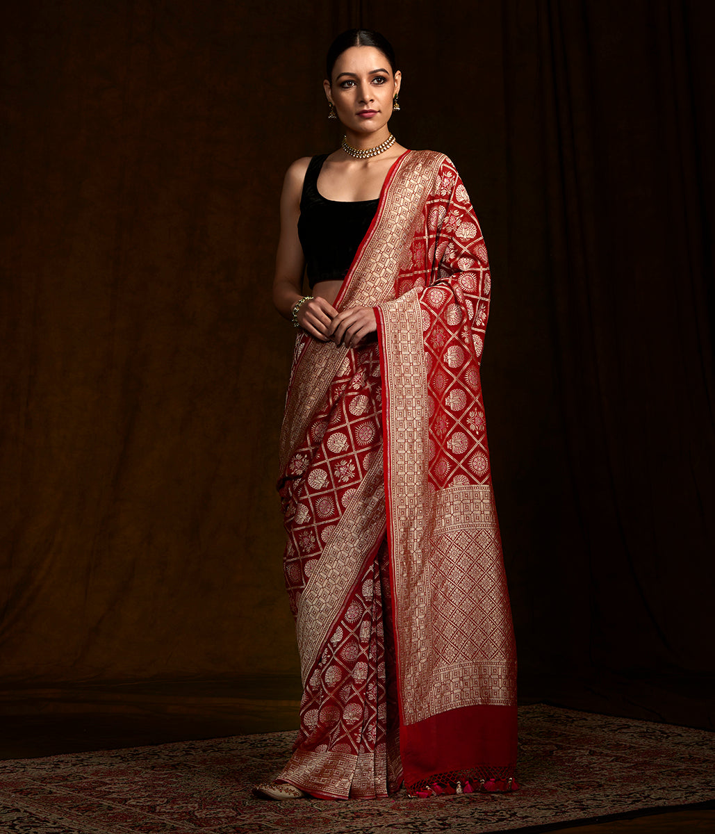 Red Banarasi georgette saree with peacock and rudraksh motifs
