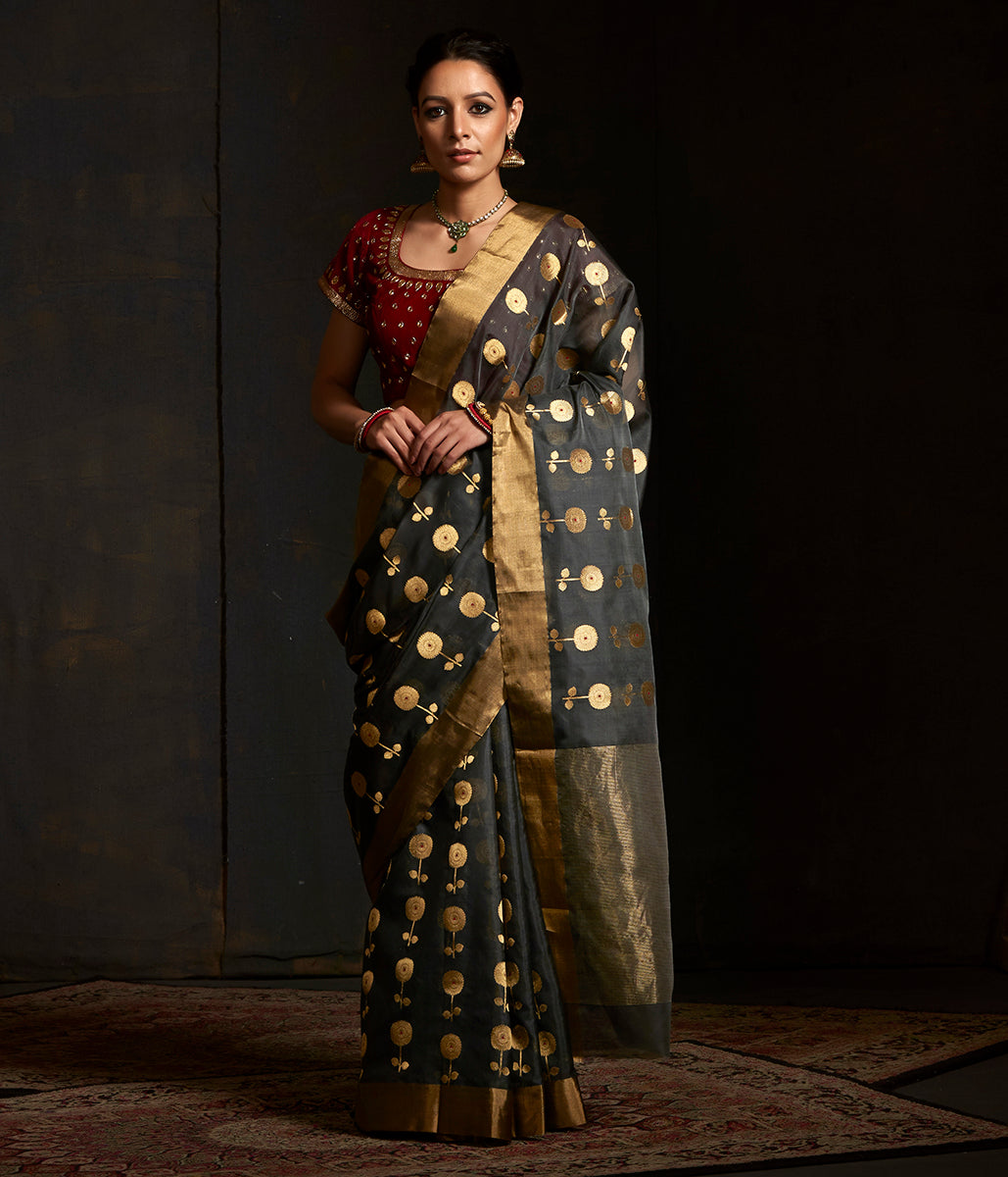 Charcoal grey chanderi silk saree with floral motifs woven in gold and silver zari
