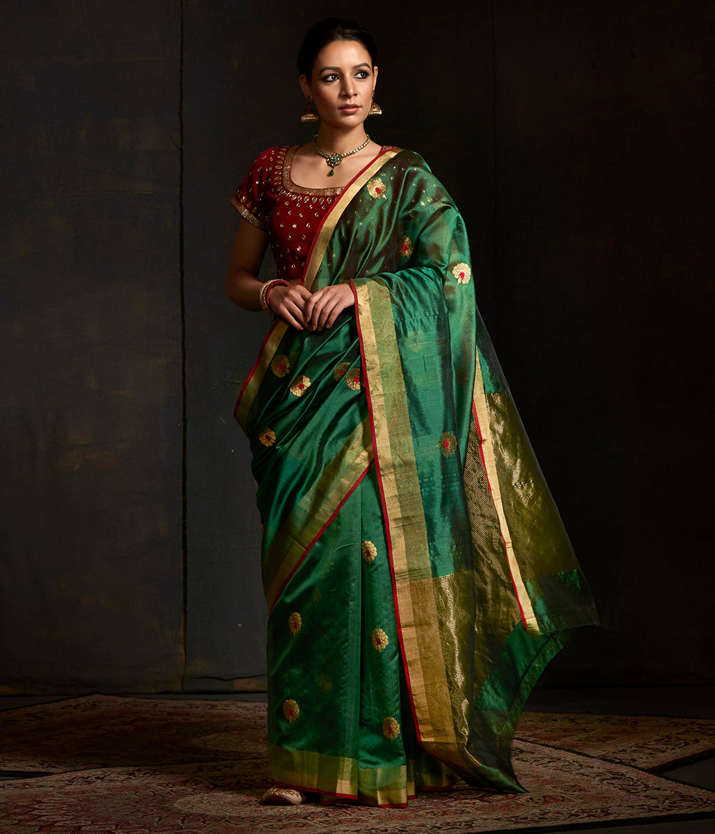 Emerald green chanderi silk saree with floral bootis in gold zari