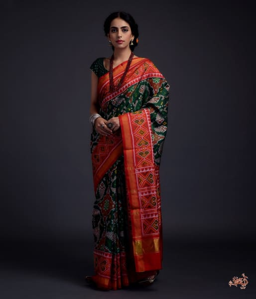 Pure Silk Gujarat Patola Saree In Green With Red Combination And Large Fish Motifs Saree