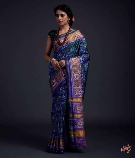 Blue Dual Tone Single Ikat Patola Saree With A Purple And Gold Tissue Border Saree
