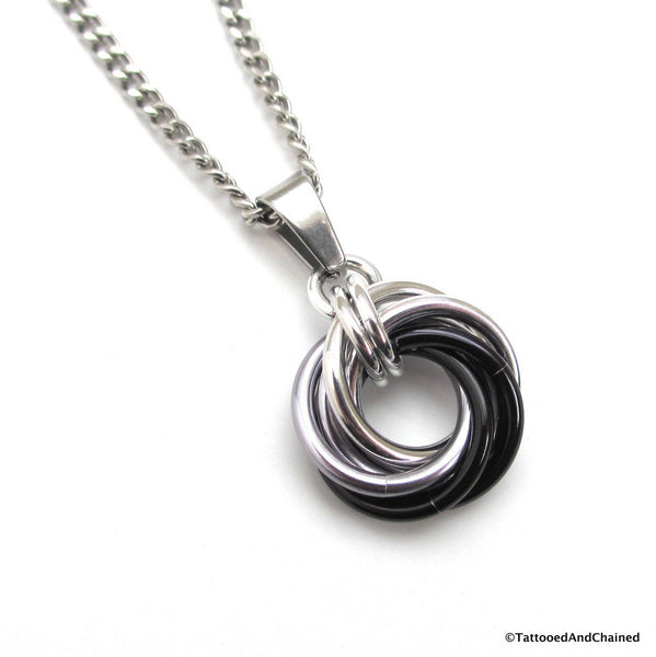 Silver, gray, and black pendant, chainmaille love knot - Tattooed and Chained Chainmaille  - 1