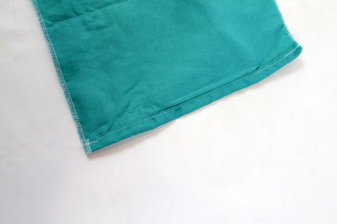 hemmed side of crib skirt